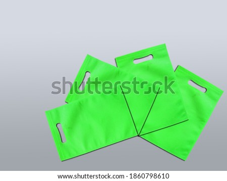 Assorted Color Bags D-Cut Type Non Woven Fabric on Background. Die Cut Gift Bags, Reduce, Reuse, Recycle. Use Me I am not Plastic. ECO Friendly Environment Concoct.   Stok fotoğraf ©