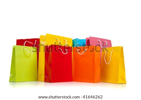 Assorted colored shopping bags including red, yellow, lime green, orange, pink and blue on a white background