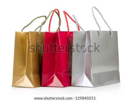 Assorted colored shopping bags on a white background