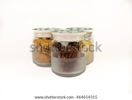 Assorted cookies in glass jars isolated on white #464654315