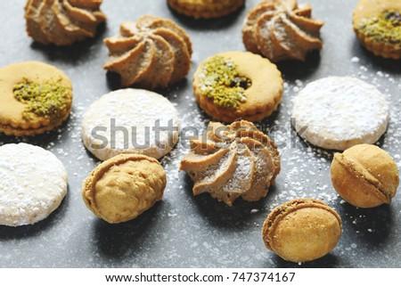 Assorted cookies: linzer cookies,shortbread, nuts cookie, orange almond cookie, selective focus #747374167