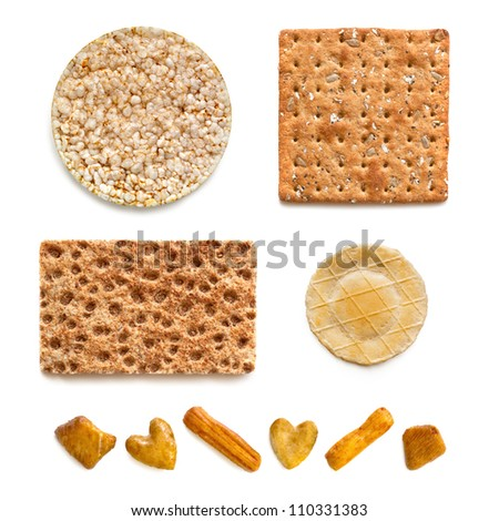 Assorted crackers, isolated on white background.  Includes rice, wholegrain, rye, cheese cracker, and rice cracker party snacks.