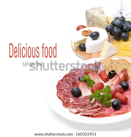 assorted deli meats and a plate of cheese, isolated on white