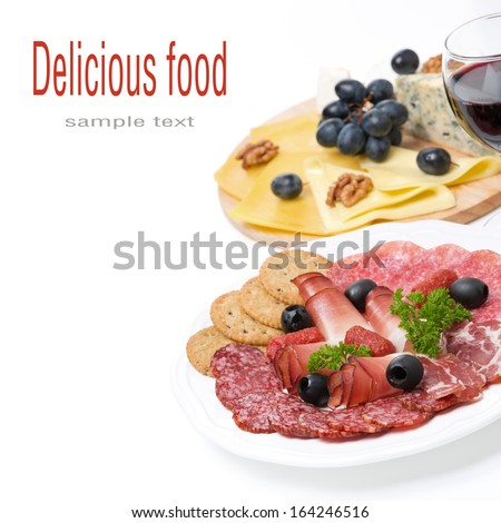 assorted deli meats, plate of cheese and a glass of wine, isolated on white