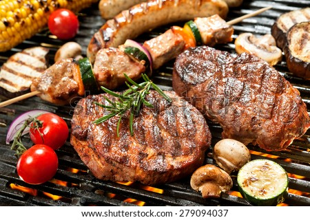 Assorted delicious grilled meat with vegetable over the coals on a barbecue #279094037