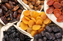 Assorted dried fruits in bags.