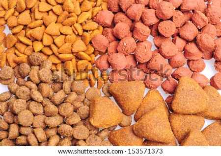 Assorted Dry dog food close up, isolated on white background