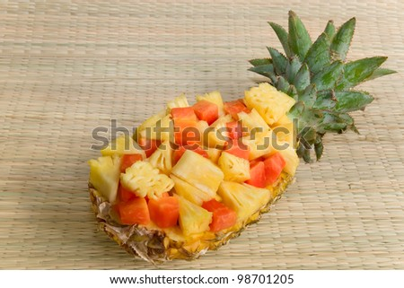 Assorted exotic fresh fruits in a pineapple skin