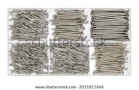 Assorted flat headed steel wire nails in a clear plastic box. Set of round nails for use in daily life, in a plastic kit. Common inexpensive hardware. Close-up, from above, isolated over white. Photo. Photo stock ©