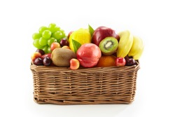 assorted fresh fruits in a square basket isolated on white background, with copy space.