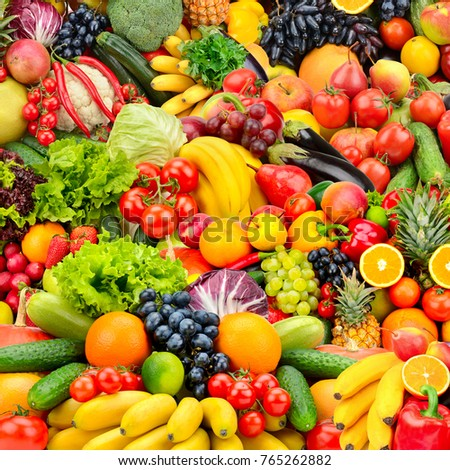 Assorted fresh ripe fruits and vegetables. Food concept background. Top view. Copy space. - Shutterstock ID 765262882