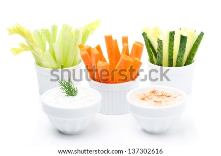 Assorted fresh vegetables (celery, cucumber and carrot) and two yogurt sauce isolated on white background