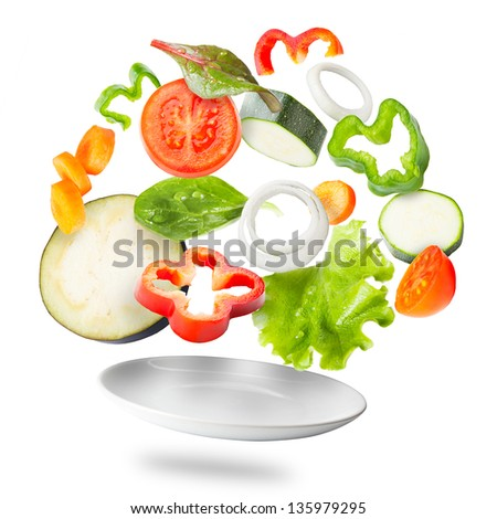 Assorted fresh vegetables flying in a plate / Light salad with flying fresh vegetables #135979295