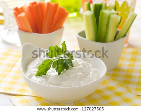 Assorted fresh vegetables with dip, selective focus