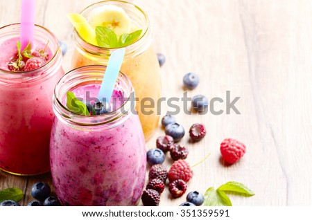 Assorted fruit shakes on white table. Smoothie concept