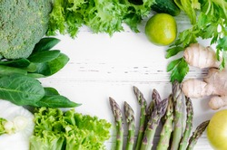 Assorted green vegetables food background as a healthy eating concept of fresh garden produce organically grown as a symbol of health. Raw greens. Detox, clean eating. Flat lay. Copy space. Top view.