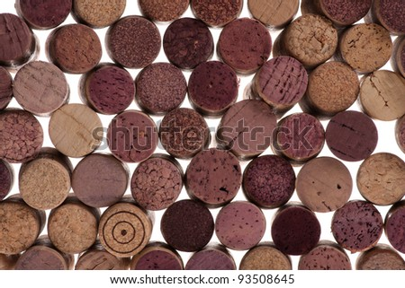 Assorted group of used corks on a white background. viewed from the front.