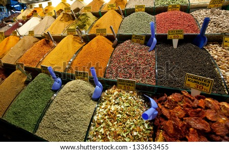 assorted herbs and spices in the market, cloves, nutmeg, curry, chili powder, crushed chillies, dill seed, thyme, peppercorn, anise