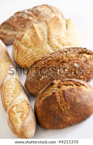 Assorted kinds of fresh baked bread in a row