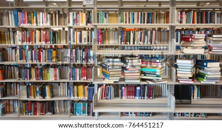 Assorted library books on shelves, titles are blurred                                #764451217