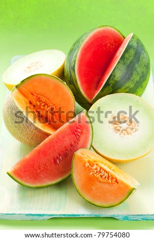 assorted melons and watermelon on the table - stock photo