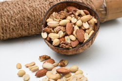 Assorted mixed nuts, India. hazelnuts, walnuts, almonds, cashew, ground/pea nuts. Healthy natural fiber. Indian dry fruits in coconut shell. Food rich in unsaturated fat, protein, omega 3 fatty acid