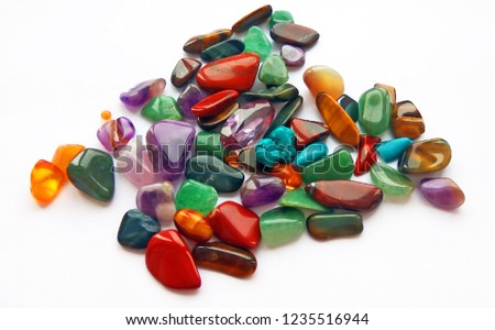 Assorted natural bright coloured semi precious gemstones and gems on white background #1235516944