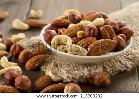 Shutterstock Assorted nuts (almonds, hazelnuts, cashews, peanuts)
