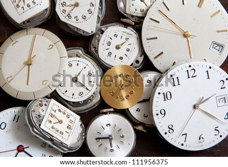 Assorted old, wrist watch faces creating a background