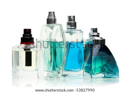 Assorted perfume  bottles on white background, selected focus