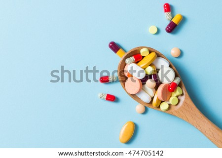 Shutterstock Assorted pharmaceutical medicine pills, tablets and capsules on wooden spoon