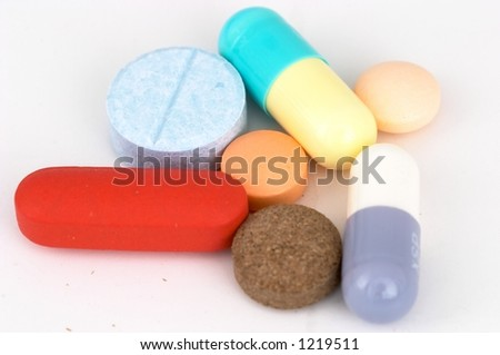 Assorted Pills and Capsules on white background
