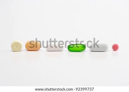 Assorted pills  on white