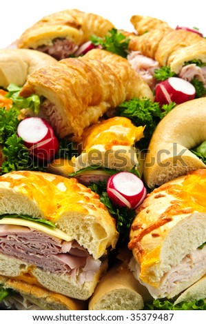Assorted platter of sandwiches with meat and vegetables