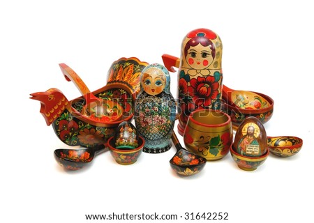 Assorted Russian folk wooden toys and utensils isolated