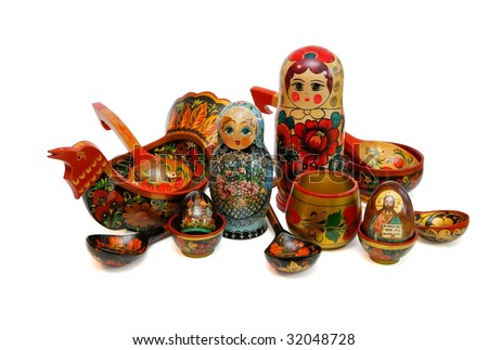 Assorted Russian wooden toys, kitchen utensils ans religious objects isolated