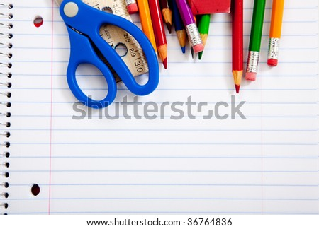 Assorted school supplies with a notebooks, pencils, pens, scissors etc.