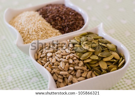 Assorted seeds in bowl pumpkin, sunflower, sesame, flax
