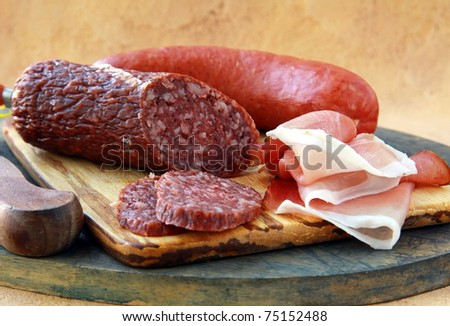 Assorted several kinds of sausages and smoked meats on a cutting board