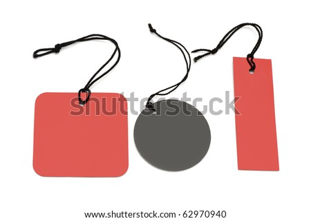 Assorted shape price labels with black strings on white background