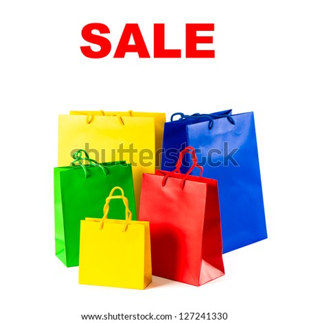 assorted shopping bags on white background. sale concept with sample text