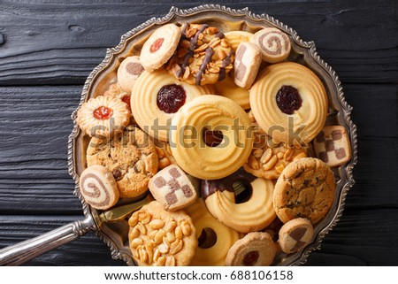 Assorted shortbread cookie close-up on a plate on a table. horizontal view from above