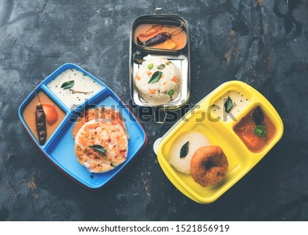 Assorted South Indian tiffin / lunch box food in group, includes idli vada, uttapam/uthappam, upma with sambar and chutney