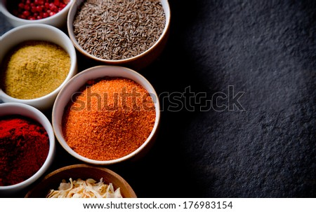 Assorted spices on stone background #176983154