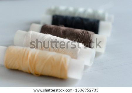 assorted spools of sewing threads #1506952733