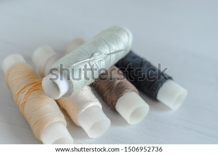 assorted spools of sewing threads #1506952736
