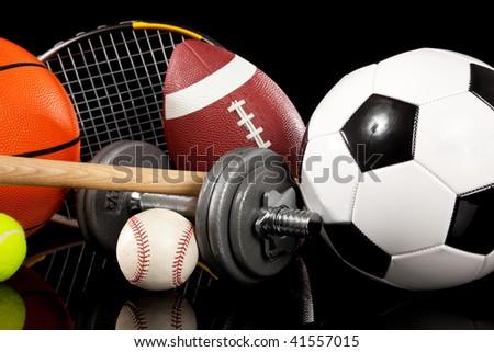 Assorted sports equipment including a basketball, soccer ball, tennis ball, bat, tennis racket,  football, dumbbells and baseball