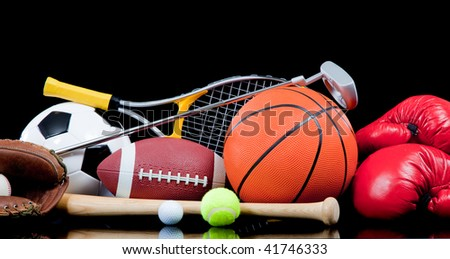 Assorted sports equipment including a basketball, soccer ball, tennis ball, golf ball, bat tennis racket, boxing gloves, football, golf and baseball glove