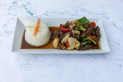 Assorted Thai food in flat lay composition, Thai Food Mixed Dishes, Asian food rice noodle served with chicken in Teriyaki sauce and sesame seeds, top viewAssorted Thai food in flat lay composition,