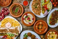 assorted Turkish dishes, hummus, muhamara, mutabal, falafel, shawarma